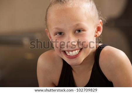 Close up of a happy biracial child dancer - stock photo