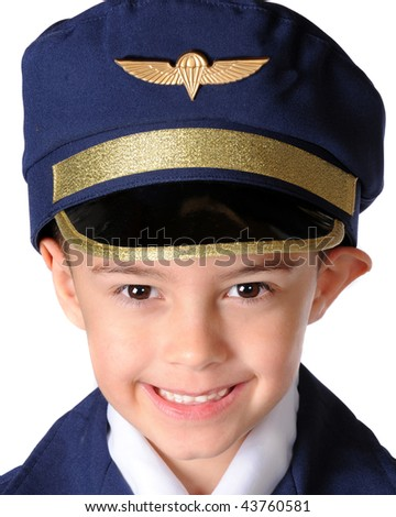 Close-up of a happy kindergarten boy in an over-sized airline pilot's uniform.  Isolated on white. - stock photo