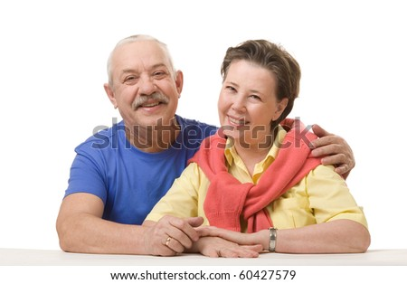 Close-up of a happy senior couple. Hugging and looking at camera. - stock photo