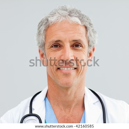 Close up of a happy senior Doctor in a hospital - stock photo