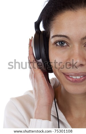 close-up of a happy woman enjoying with headphones music. Isolated on white background. - stock photo