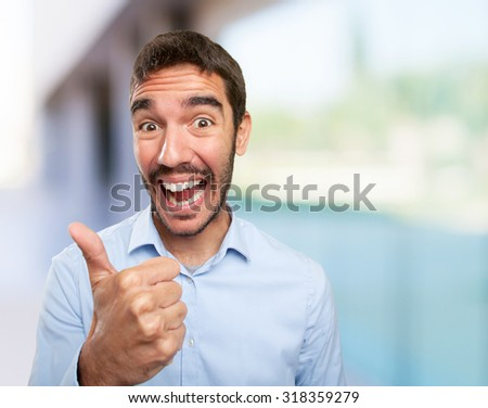 Close up of a happy young man okay gesture - stock photo