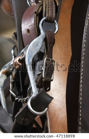 Close up of a horse bridle and bit. Vertical shot. - stock photo