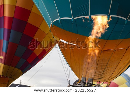 close up of a hot air balloon flame heating the air inside of the balloon - stock photo