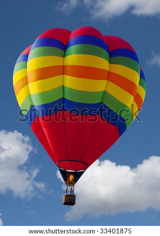 close up of a hot air balloon flying in the sky