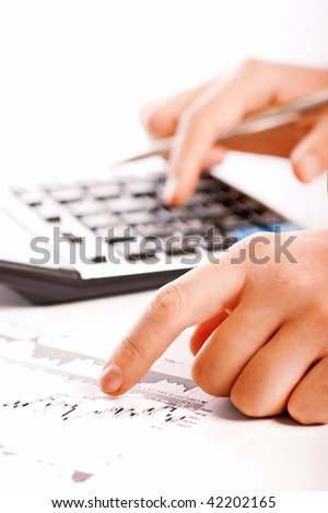 Close-up of a human hand and stock chart - stock photo