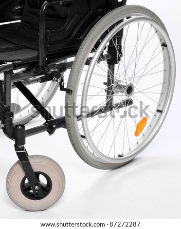 Close up of a invalid chair wheels. - stock photo