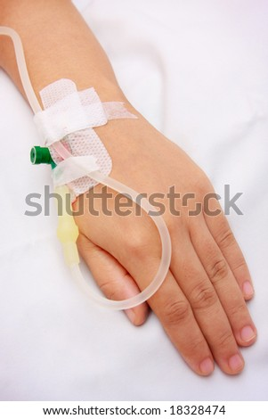 close up of a iv drip in patient's hand - stock photo