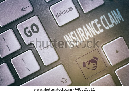 Close up of a keyboard with a Insurance Claim concept.