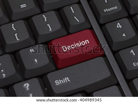 Close up of a keyboard with red enter button written DECISION - stock photo