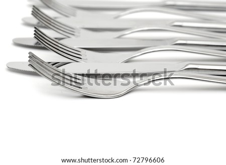 close up of a knife and fork on white background - stock photo