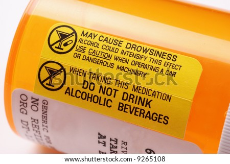 Close-up of a label on a bottle of prescription medication warning not to consume alcohol while using the drug - stock photo