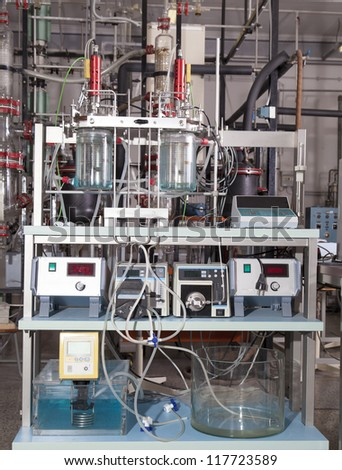 Close up of a laboratory equipment for destillation and various chemical experiments with precice electronic instruments - stock photo