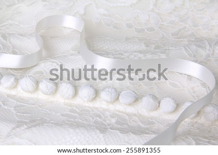 Close up of a lace overlay wedding dress. Shallow depth of field, focus on the center.  - stock photo