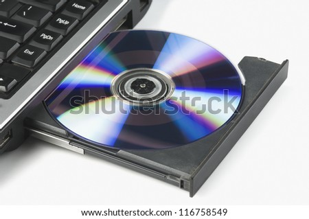 Close-up of a laptop ejecting a DVD