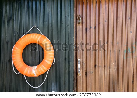 close-up of a lifebelt on a wooden door.  - stock photo