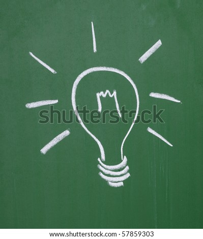 close up of a light bulb drawing on blackboard - stock photo
