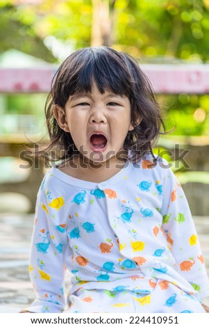 Close up of a little baby girl and opening their own mouths - stock photo