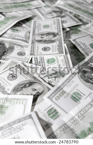 Close-up of a lot of hundred dollar banknotes - stock photo