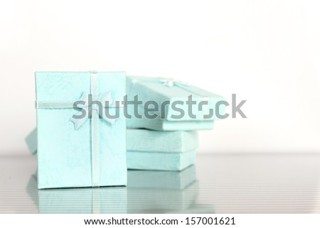 Close-up of a lot of small gift boxes for jewelry - stock photo