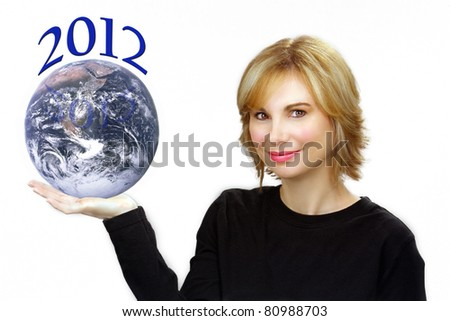 "Close-up of a lovely young sandy-blonde woman holding the earth and ""2012"" in her right hand."