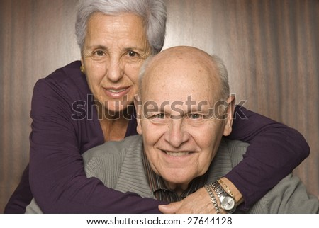 Close-up of a loving, handsome senior couple - stock photo