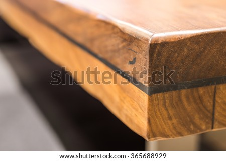 Close-up of a luxurious table corner , vintage solid wood furniture detail - stock photo