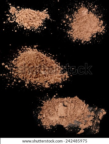 Close up of a make up powder on black background - stock photo