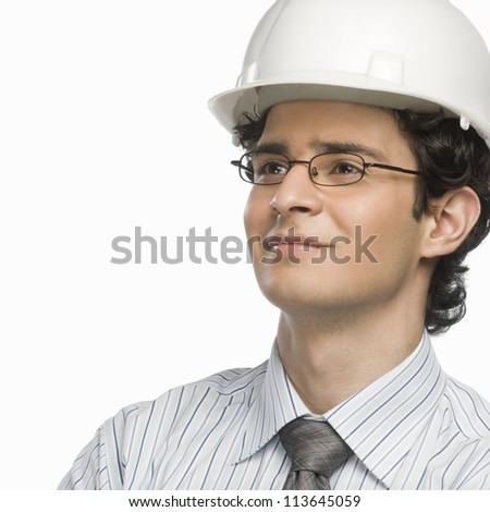 Close-up of a male architect smiling - stock photo