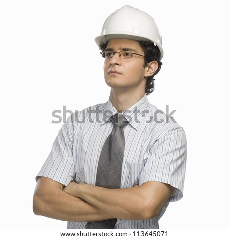 Close-up of a male architect with his arms crossed - stock photo