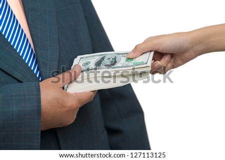 Close up of a male hand taking bribe - stock photo