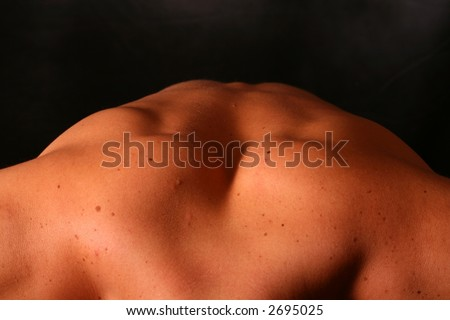 Close up of a male models back in a strange bose. - stock photo