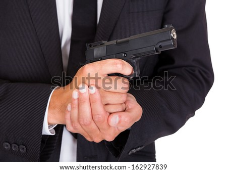 Close-up Of A Male Spy In Suit Holding Handgun - stock photo