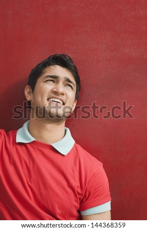 Close-up of a man day dreaming - stock photo