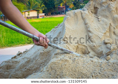 Close up of a man digging soil with shovel - stock photo