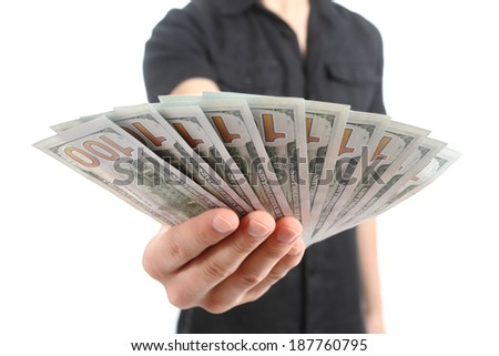 Close up of a man hand offering money banknotes isolated on a white background                 - stock photo