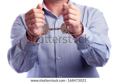 Close up of a man in handcuffs arrested   - stock photo