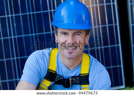 Close up of a Man in his forties overseeing a Solar Installation focus on his eye on you to think of energy