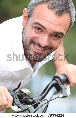 close-up of a man on a bike - stock photo