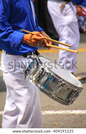 Close up of a man playing drum during Festival of the Virgin de la Candelaria in Lima, Peru. The core of the festival is dancing and music performed by different dance schools. - stock photo