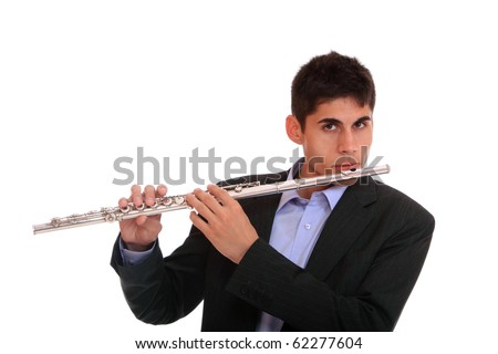 Close up of a man playing his flute. - stock photo
