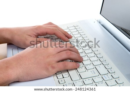 close up of a man's hands to the white computer