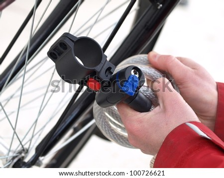 Close up of a man tying his bike - stock photo