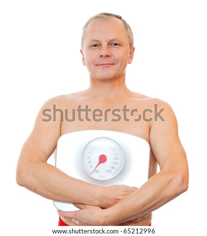 Close-up of a man with weight scale - stock photo
