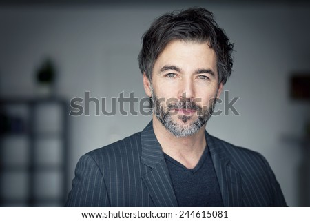 Close up OF A Mature Man Looking At The Camera - stock photo