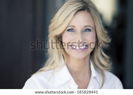 Close up Of A Mature Woman Smiling - stock photo