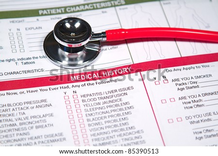 Close up of a Medical History form and a doctor's Stethoscope - stock photo
