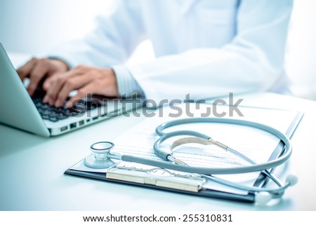 Close-up of a medical worker with laptop - stock photo