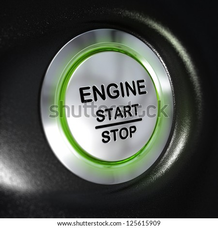 close up of a metallic engine start and stop button, green light, blur effect, automotive starter concept. Black background