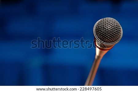 Close up of a microphone in conference hall. - stock photo